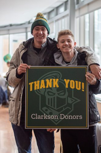 Two smiling students happy to thank Clarkson Donors for their efforts and contributions on Grateful Golden Knights Day